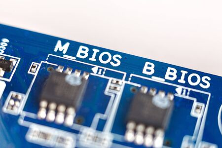 BIOS chips close-up macro on the motherboard of the computer, the firmware of the electronic device gadget
