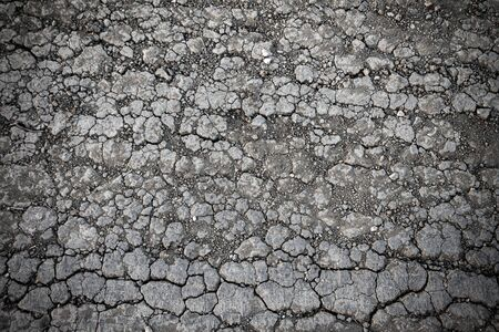 arid land cracked by drought, lack of precipitation and rain Stock Photo - 140208836