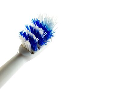 old bad toothbrush, the concept of changing toothbrush once a month, hygiene of the oral cavity