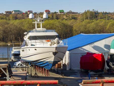 yacht parking on land, boat storage, port and marine hangar