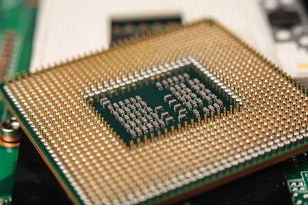 computer CPU close-up on the motherboard background, socket of central process unit, connection of cpu with motherboard, the structure of the processor chip, multi-core and multi-threading