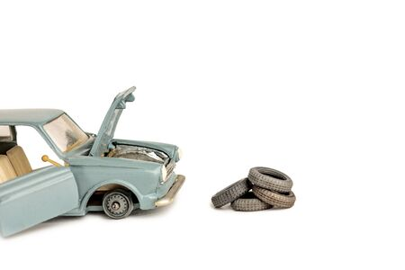 toy car with removed tires, tire and car repair service Banco de Imagens