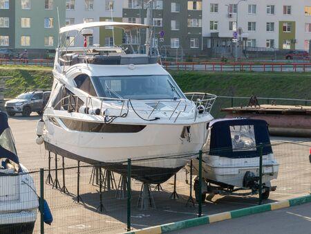 yacht parking on land, boat storage, port and marine hangar