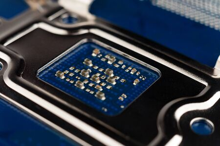 a chip in a computer with many electrical elements, a CPU, a GPU, a microchip in an electronic device, a multi-core multithreaded processor crystal, close up, macro