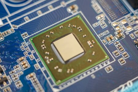 a chip in a computer with many electrical elements, a CPU, a GPU, a microchip in an electronic device, a multi-core multithreaded processor crystal, close up, macro Banque d'images