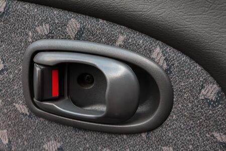 opening handle of the vehicle doors, the locking button from accidentally opening while on the move, the safety of the children in the car