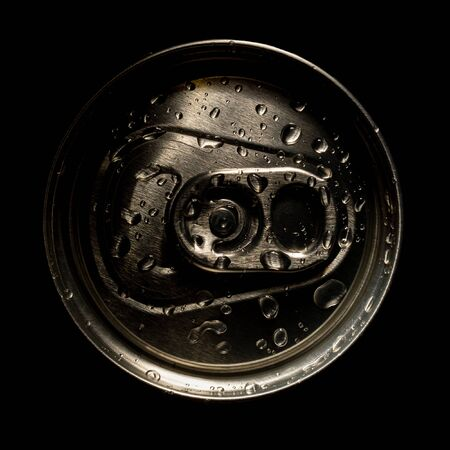 aluminum soda and beer beverage can with water droplets isolated on dark background, metal can, recyclable product
