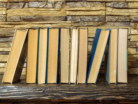 books on the bookshelf, the concept of reading and publishing