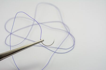 medical thread for suturing wounds, surgical needle holder, suturing in medical and dental practice