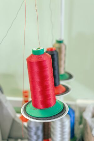 coils spools with threads for weaving machine close-up