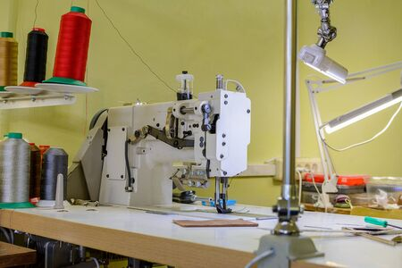 professional production sewing machine close-up, leather production, seamstress, tailor