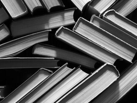 books on the bookshelf, the concept of reading and publishing, black and white photo