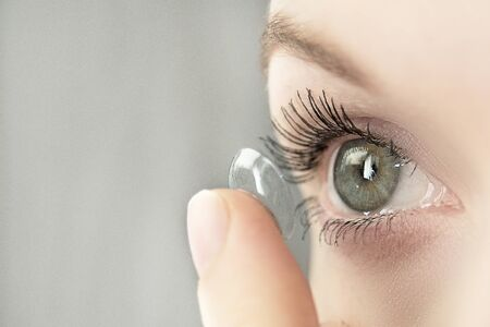 girl wearing soft contact lenses close-up macro