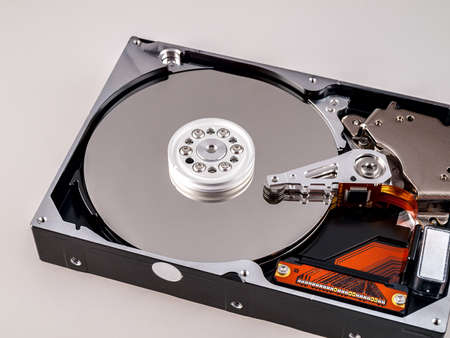 mechanical movable hard disk, with magnetic head in disassembled state, view of the drive hard disk plates, isolated
