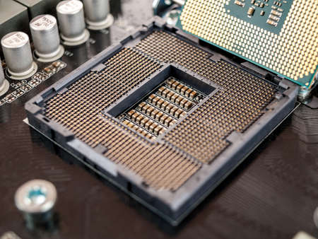 contacts for connecting the CPU on the motherboard to the processor socket, close-up macro, selective focus, selection of computer components for games and work