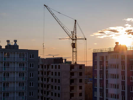 Construction crane for the construction of blocks of apartment buildings, new buildings, renovation and modernization, improvement of the urban environment, selective focus
