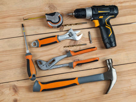 tools for work and repair, screwdriver, hammer, screwdriver, keys and fasteners, template, copy space
