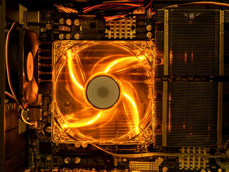 cooling fan with backlight in the computer system unit, cooling the computer air, repair and upgrade, cooling computer components 免版税图像