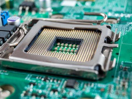 installing the correct central processing unit in the socket connector of the computer's motherboard, selecting the CPU, damaging the micro-contacts of the processor connector, close-up, macro