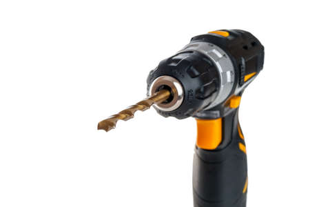 electric drill with battery, portable screwdriver for tightening screws and bolts and drilling, dowels and screws for home repairs with your own hands, selective focus on the drill, close-up