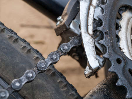 bicycle chain with links close-up, chain repair and replacement, mountain bike bicycle chain lubrication