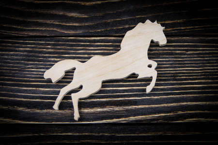 Horse on old wood background photo