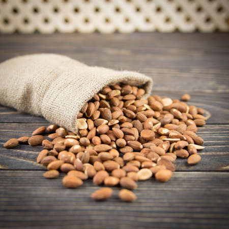 Almonds on rustic wooden background Imagens