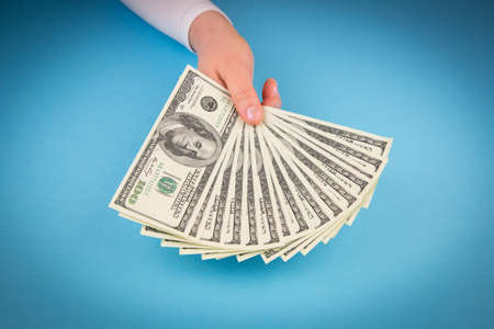 Hand holding money dollars photo