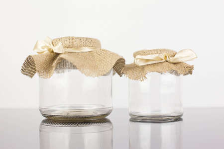 Empty glass jar with packaging sacking Stock Photo