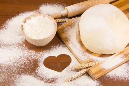 Raw dough on wood background Standard-Bild