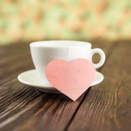 tea ceremony with heart on an old wooden background photo