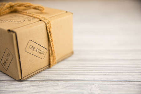 cardboard box isolated on white wood background photo