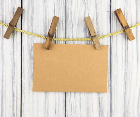 Paper nameplate on old wood background photo