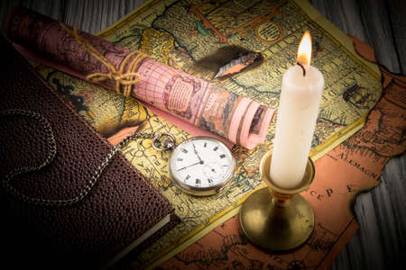 Antiquarian pocket watch and ancient world maps Stock Photo - 26865629