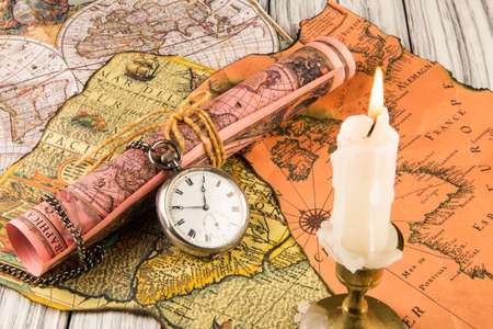 Antiquarian pocket watch and ancient world maps photo