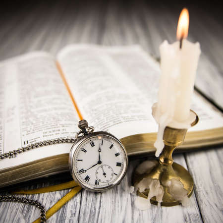 The Bible opened and pocket watch photo