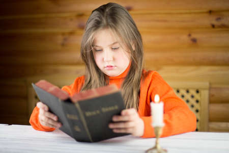 The girl reads the Bible photo