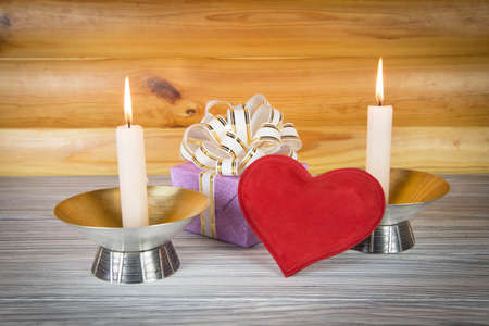Gift with romantic candlelight photo
