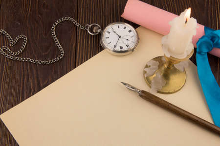 The old handle feather and a sheet of paper with a candle photo
