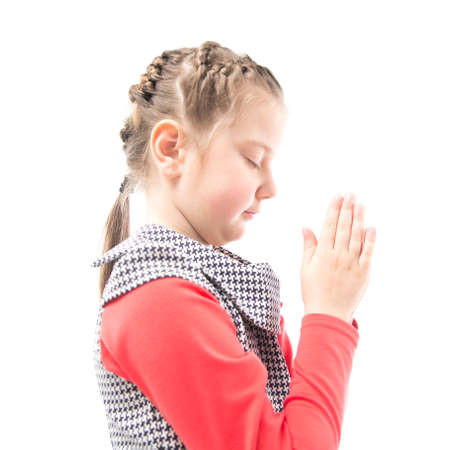 The girl prays on white background photo