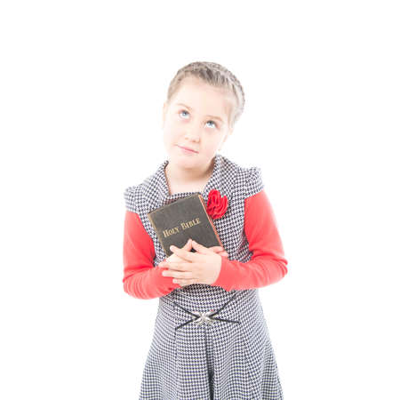 The girl reads the Bible on white background photo