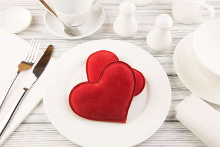 ware: Ware for food white and heart on a wooden table