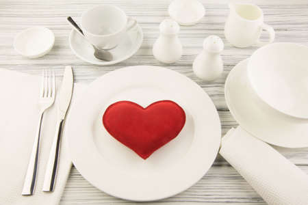 Ware for food white and heart on a wooden table photo