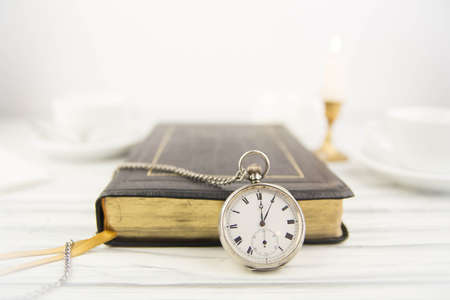 The Bible and pocket watch photo