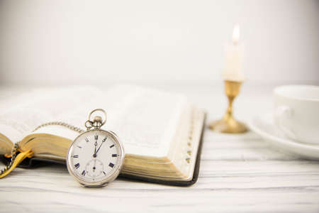 The Bible opened and pocket watch
