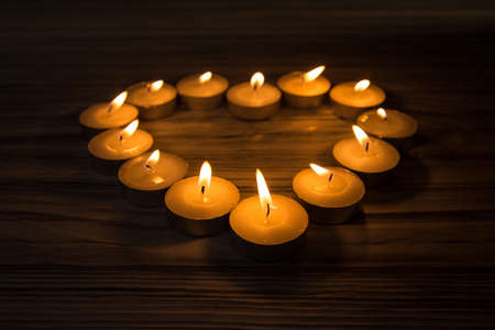 Heart and candles on a wooden background photo