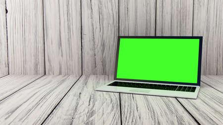 Laptop on wood background photo