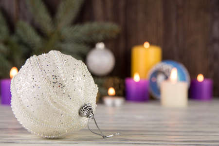 Christmas tree decorations with candles on an old wooden background photo