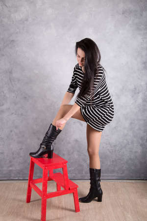 Beautiful young woman in a trendy shoes photo
