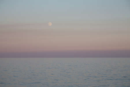 ascending: The ascending moon against the sea